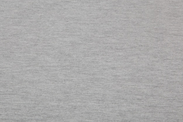 Tessuto a maglia grigio melange reale realizzato in fibre sintetiche con texture di sfondo.