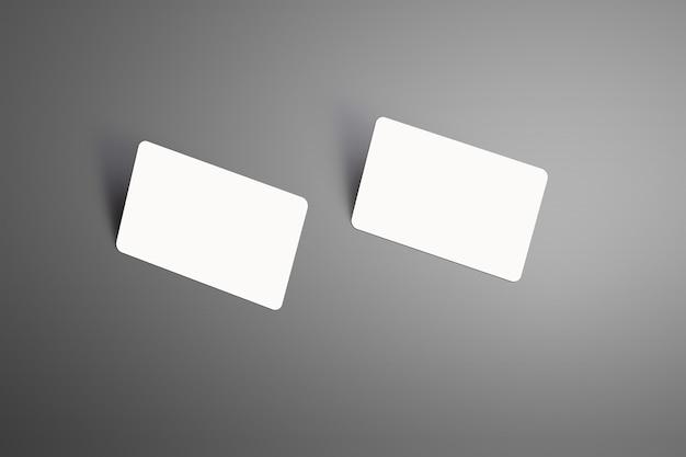 Due carte regalo realistiche della banca bianca in piedi sull'angolo con sfondo isolato ombre. pronto per essere utilizzato nella tua vetrina.