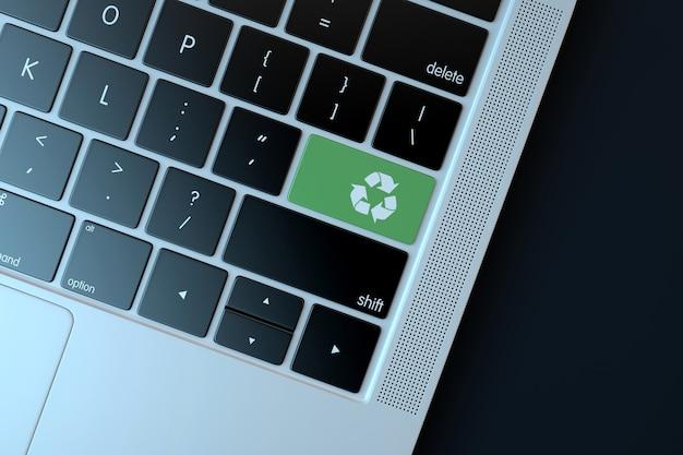 Ricicla l'icona sulla tastiera del laptop. concetto di tecnologia