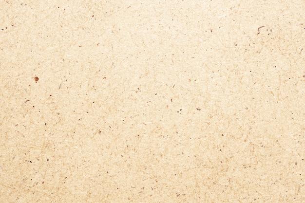 Riciclare la priorità bassa di struttura della superficie del cartone della carta kraft