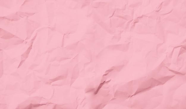Sfondo di carta sgualcita rosa pastello riciclato o superficie di cartone da una scatola di carta per l'imballaggio per il concetto di decorazione di disegni