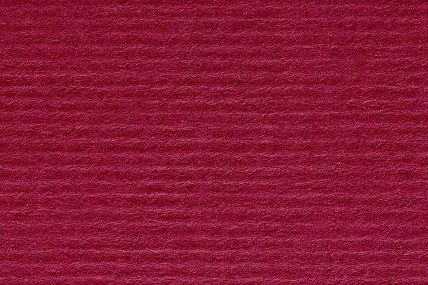 Fondo di carta astratto rosso o struttura del cartone del modello della banda. foto ad alta risoluzione.