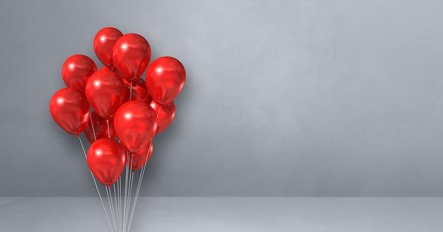 Mazzo di palloncini rossi su un muro grigio