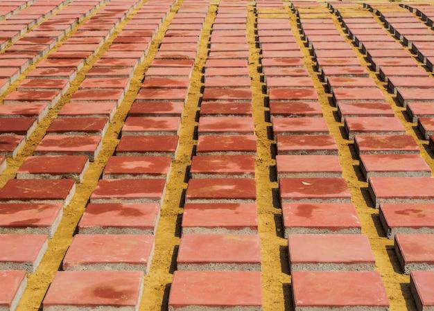 Mattone rosso per il pavimento in costruzione