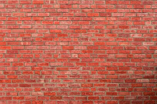 Fondo rosso di struttura del muro di mattoni Foto Premium