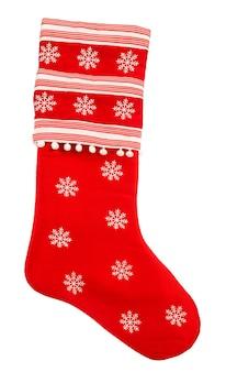 Calzino rosso di natale con i fiocchi di neve per i regali su fondo bianco. simbolo delle feste