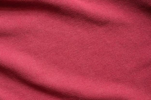 Fondo rosso del modello di struttura del tessuto dell'abbigliamento