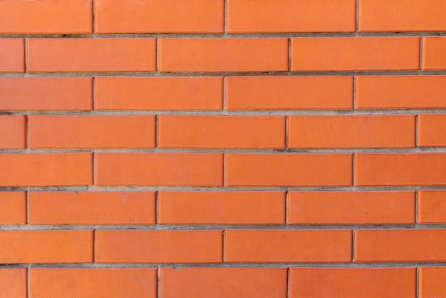 Muro di mattoni di colore rosso per la progettazione del fondo della muratura