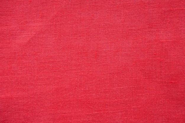 Priorità bassa di struttura della tela di lino di colore rosso