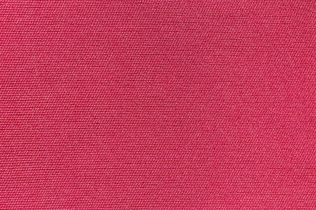 Priorità bassa di struttura del poliestere panno tessuto rosso.