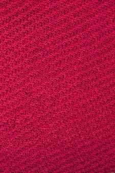 Priorità bassa di struttura del tessuto rosso, texture per il design. può essere utilizzato come sfondo, carta da parati.
