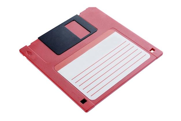 Disco floppy rosso. vecchia unità. isolato su sfondo bianco + tracciato di ritaglio