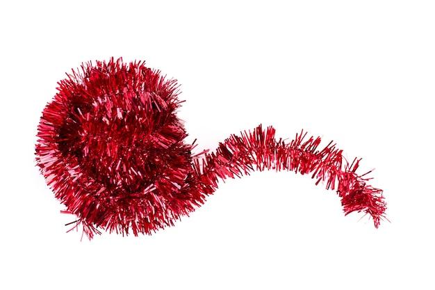 Orpello di natale glitter rosso, sfondo bianco.
