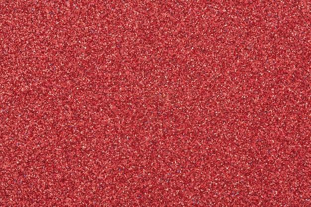 Trama di carta rossa scintillante o sfondo. sovrapposizione scintillante per il design.