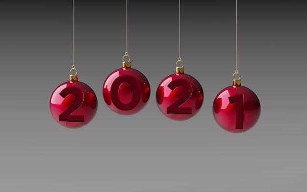 Palle di natale lucide rosse che appendono con i numeri del nuovo anno incisi, fondo grigio