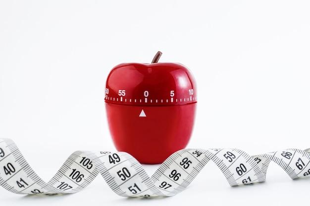 Timer da cucina rosso sotto forma di una mela rossa
