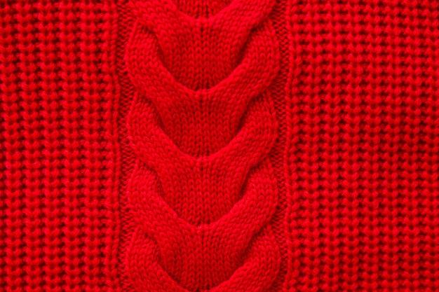 Maglione invernale lavorato a maglia rosso sfondo, trama rossa