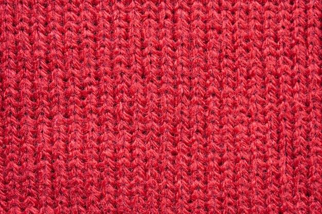 Priorità bassa di struttura del tessuto di lana lavorata a maglia rossa