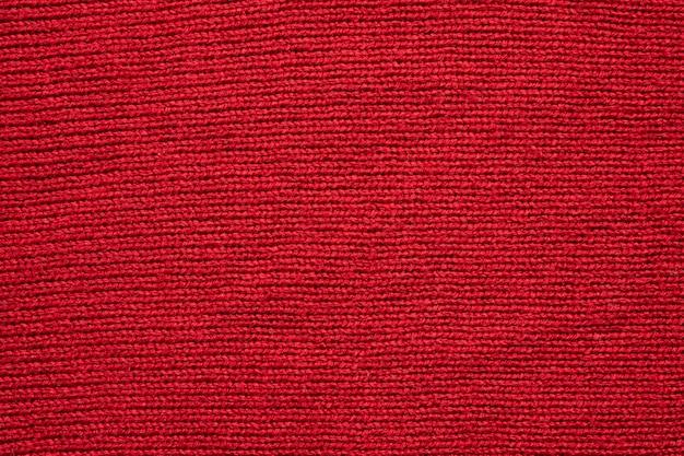 Priorità bassa di struttura di lana lavorata a maglia rossa
