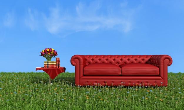 Sofà di lusso di cuoio rosso su erba