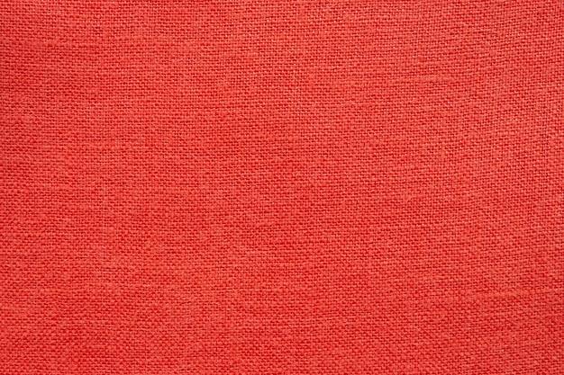 Priorità bassa di struttura del tessuto di tela di lino rosso