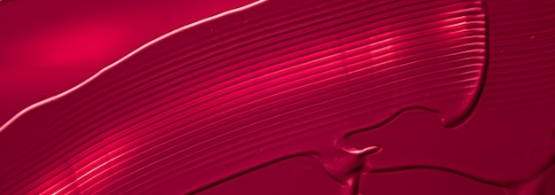 Rossetto rosso o lucidalabbra texture come sfondo cosmetico trucco e prodotti cosmetici di bellezza per lux...