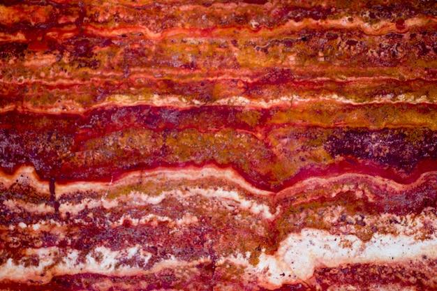 Fondo di struttura di marmo rosso, marmo naturale della breccia per la parete e le piastrelle del pavimento di ceramica, marmo rosso lucido, struttura di pietra di marmo naturale reale e fondo di superficie.