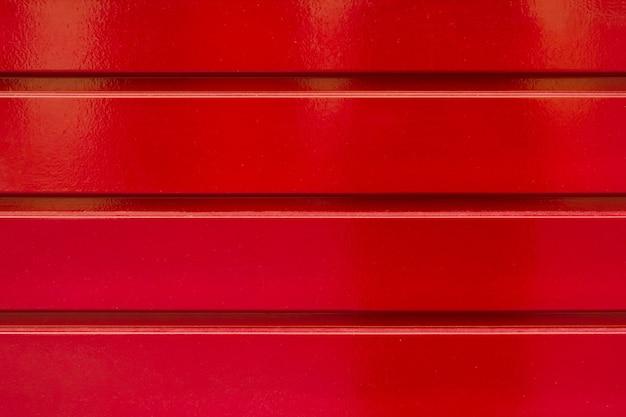 Texture di sfondo in metallo rosso con strisce