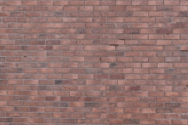 Vecchio fondo rosso di lerciume di struttura del muro di mattoni con gli angoli vignetted a interior design