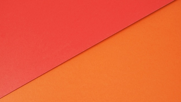 Carta di colore rosso e arancione per lo sfondoè uno spazio vuoto e nessuna gente