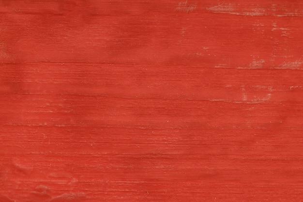 Vernice rossa su una superficie di legno. sfondo per il design