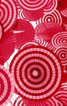 Arte decorativa di carta pieghettata rossa e rosa per sfondo astratto