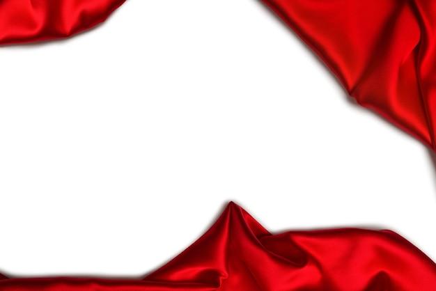 La trama del tessuto di lusso in seta rossa o satinata può essere utilizzata come sfondo astratto. vista dall'alto.