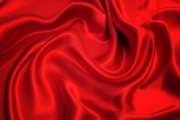 La trama del tessuto di lusso in seta o raso rosso può essere utilizzata come sfondo astratto.