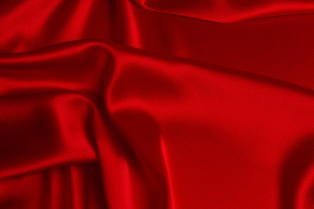 Trama del tessuto di lusso in seta o raso rosso