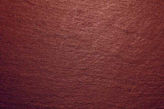 Priorità bassa rossa di struttura del vassoio dell'ardesia. texture di roccia ardesia nera naturale