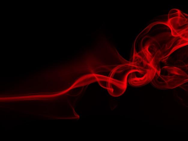 Estratto rosso del fumo su fondo nero, progettazione del fuoco