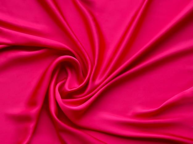 Primo piano di trama di sfondo di raso lussuoso elegante liscio rosso - carta da parati astratta