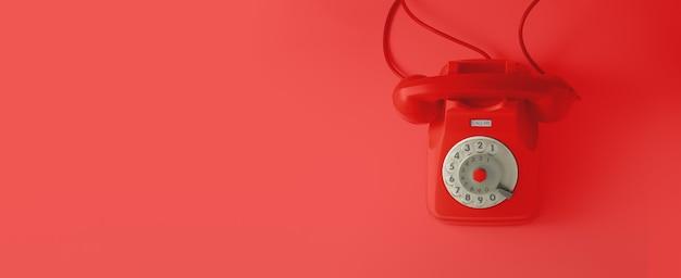 Un telefono con linea vintage rosso con sfondo rosso.