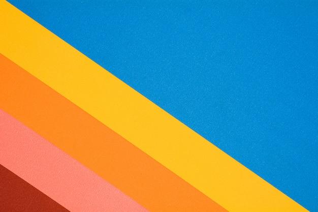 Texture di carta rossa, gialla, rosa, blu e arancione