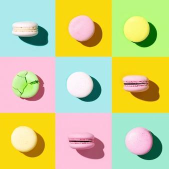 Modello creativo regolare di macarons colorati biscotti francesi. striscione in stile pop art.
