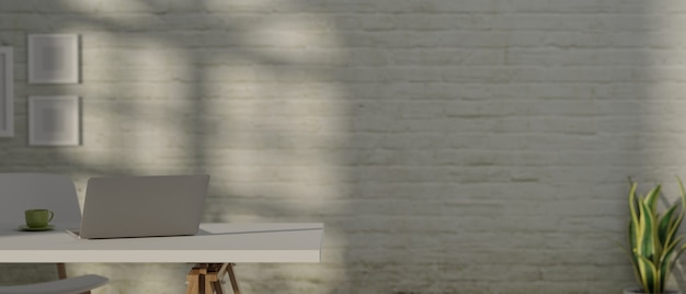 Rendering dell'area di lavoro con il computer portatile sul tavolo bianco e una sedia con un muro di mattoni