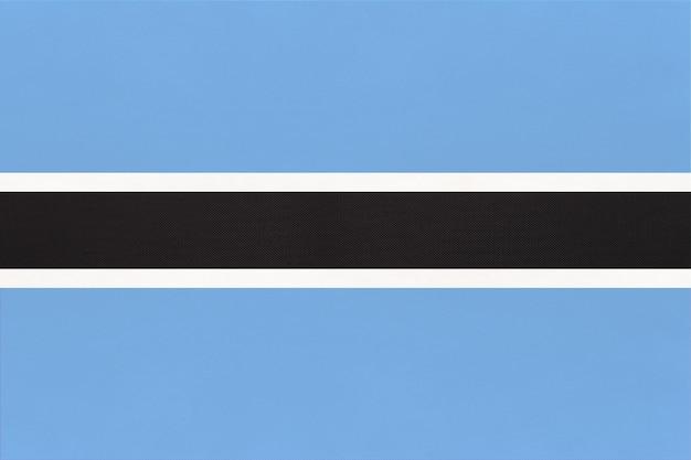 Fondo nazionale del tessuto della bandiera del tessuto della repubblica botswana. simbolo del mondo paese africano.