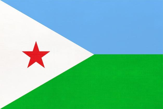 Fondo del tessuto della bandiera del tessuto nazionale della repubblica gibuti. simbolo del mondo paese africano.