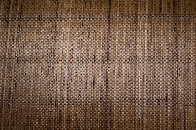 Simile alla pelle intrecciata marrone da fibre vegetali, tappeto intrecciato marrone da fibre vegetali