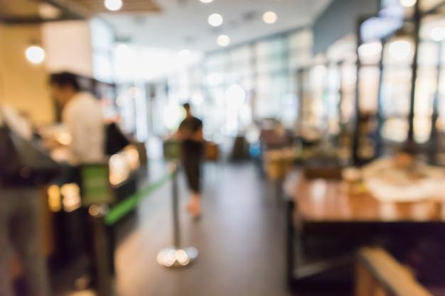 Ristorante bar o caffetteria interno con persone astratte sfocate sfocatura dello sfondo