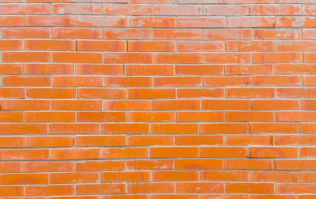 Sfondo di muro di mattoni retrò grunge arancione per architettonico