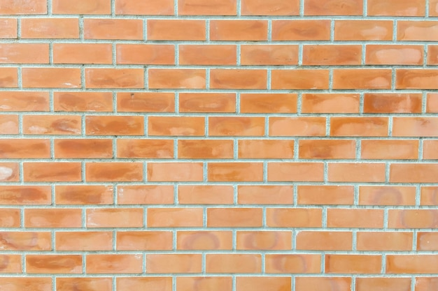 Retro priorità bassa arancione del muro di mattoni