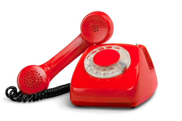 Retro telefono rosso su sfondo bianco