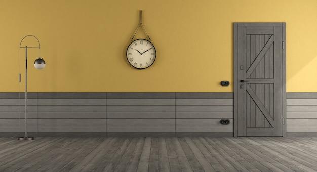 Ingresso di casa in stile retrò con porta d'ingresso, parete gialla e rivestimenti in legno grigio - rendering 3d